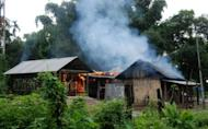 A house burns at Kachugaon village, about 230 kms from Guwahati, the capital city of the northeastern Indian state of Assam during violent clashes on July 23. New clashes took the death toll from ethnic violence in India's remote northeast to 22 on Tuesday despite an official curfew backed by shoot-on-sight orders, police said