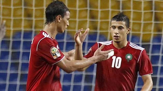 Morocco's Younes Belhanda (10) celebrates his goal against Niger with team-mate Marouane Chamakh (Reuters)