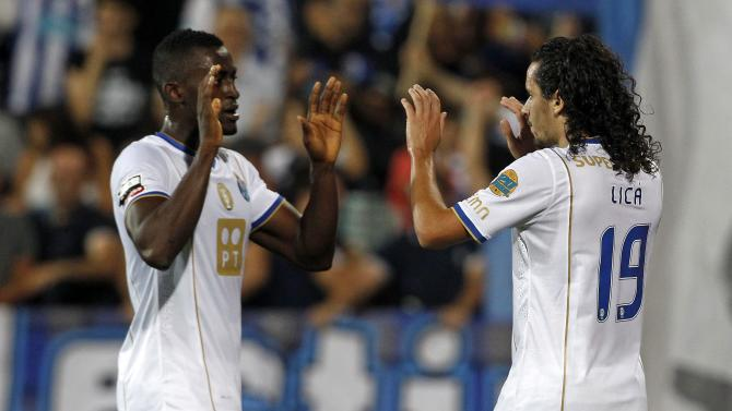 Porto's Carneiro celebrates his goal against Estoril with teammate Martinez during their Portuguese premier league soccer match in Estoril