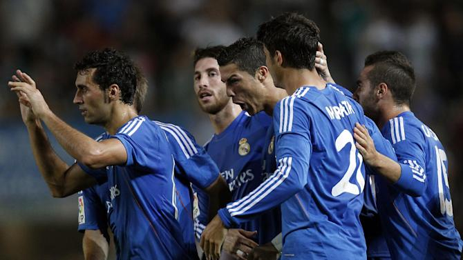 Real Madrid's Cristiano Ronaldo from Portugal, center, celebrates with fellow team members after scoring a goal against Elche during their La Liga soccer match at the Martinez Valero stadium in Elche, Spain, Wednesday, Sept. 25, 2013
