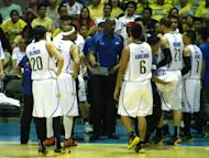 TNT coach Norman Black and his players prepare to huddle during a timeout.