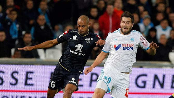 Marseille's forward Andre-Pierre Gignac, right, challenges for the ball with Sochaux's Malian defender Cedric Kante, during their League One soccer match, at the Velodrome Stadium, in Marseille, southern France, Sunday, Nov. 10, 2013