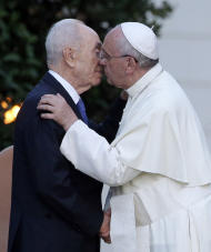 Pope Francis and Israel's President Shimon Peres, left, greet each other during an evening of peace prayers with Palestinian President Mahmoud Abbas, in the Vatican gardens, Sunday, June 8, 2014. Pope Francis waded head-first into Mideast peace-making Sunday, welcoming the Israeli and Palestinian presidents to the Vatican for an evening of peace prayers just weeks after the last round of U.S.-sponsored negotiations collapsed. (AP Photo/Gregorio Borgia)