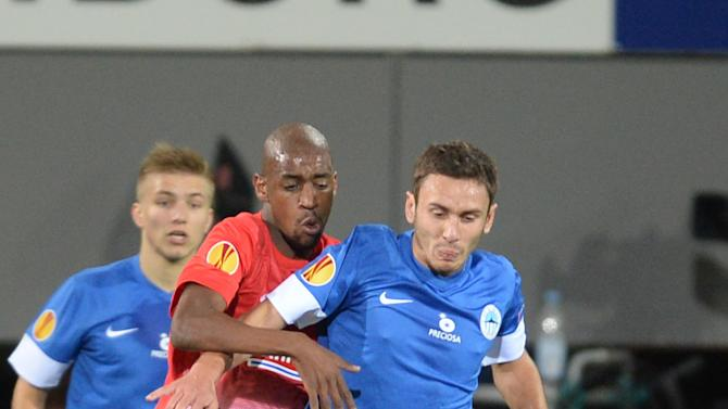Gelson Fernandes,  second left,  of Freiburg and Serhiy Rybalka   of Liberec, right,   challenge  for the ball during the UEFA Europa League Group H   soccer match between SC Freiburg and Slovan Liberec FC  in Freiburg, Germany,  Thursday Sept. 19, 2013