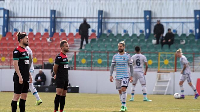 Amedspor players stand still to protest Turkish Football Federation after the kick-off their Turkish Cup quarter final first leg soccer match against Fenerbahce in the Kurdish-dominated southeastern city of Diyarbakir,