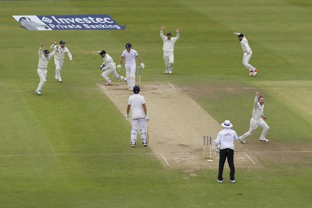 As bowler of Kane Williamson, bottom right, celebrates England's Ben Stokes, upper centre left, reacts after being caught for 2 by New Zealand's Luke Ronchi, third left, on the fifth day of th