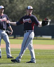 Atlanta Braves pitcher Craig Kimbrel reacts during a spring training baseball workout, Sunday, Feb. 16, 2014, in Kissimmee, Fla. The Braves agreed to terms with Kimbrel on a four-year contract. (AP Photo/Alex Brandon)