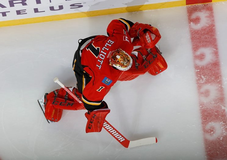 CALGARY, AB - OCTOBER 20: Brian Elliott #1 of the Calgary Flames stretches in warm up prior to the game against the Carolina Hurricanes at Scotiabank Saddledome on October 20, 2016 in Calgary, Alberta, Canada. (Photo by Gerry Thomas/NHLI via Getty Images)