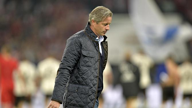 Schalke head coach Jens Keller leaves the pitch after losing the German soccer Bundesliga match between FC Schalke 04 and Bayern Munich at the arena in Gelsenkirchen, Germany, Saturday, Sept. 21, 2013. Schalke was defeated by Bayern with 0-4
