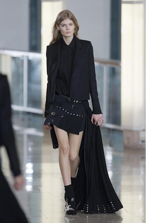 A model wears a creation for Anthony Vaccarello's Fall Winter 2015 /2016 Ready to wear fashion collection, as part of Paris Fashion Week in Paris, France, Tuesday, March 3, 2015. (AP Photo/Jacques