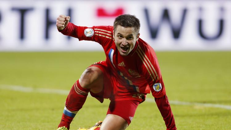 Russia's Fayzulin celebrates after scoring against Luxembourg during their 2014 World Cup qualifying soccer match in Luxembourg