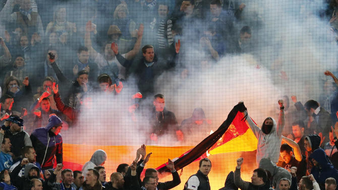 10ThingstoSeeSports - Zenit supporters burn a German flag during the Champions League round of 16 second leg soccer match between Borussia Dortmund and FC Zenit in Dortmund, Germany, Wednesday, March 19, 2014