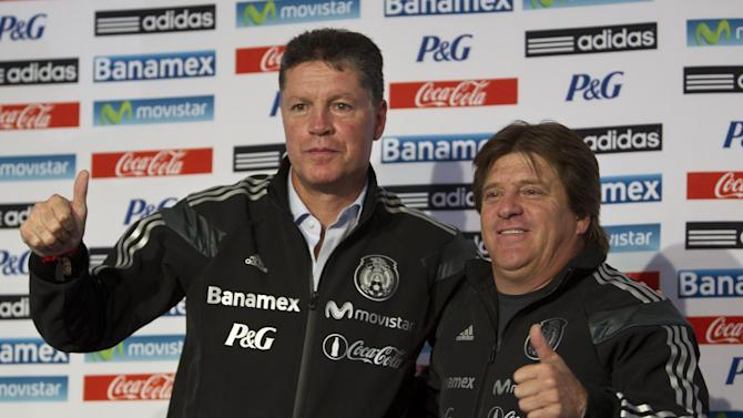 Mexico head coach Miguel Herrera, right and Ricardo Pelaez, Mexico sports director, pose during a press conference at the national team's training center in Mexico City, Friday, Dec. 6, 2013, after the final draw in Brazil for the 2014 World Cup. The Mexican national team drew Cameroon, Brazil and Croatia for their World Cup start