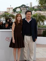 "South Korean director Hong Sangsoo and French actress Isabelle Huppert pose during the photocall of ""Da-Reun Na-Ra-E-Suh"" (In Another Country). Hong, 51, is a Cannes regular, now on his fourth turn in competition after ""Woman is the Future of Man"" and ""Tale of Cinema"" in 2004 and 2005, then ""Night and Day"" in 2008"