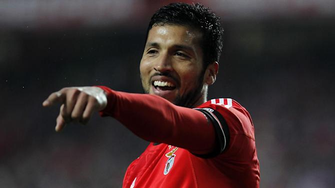 Benfica's Ezequiel Garay, from Argentina, reacts during the Portuguese league soccer match between Benfica and Porto at Benfica's Luz stadium in Lisbon, Sunday, Jan. 12, 2014. Garay scored once in Benfica's 2-0 victory