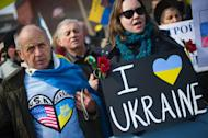Demonstrators stand with placards and chant during a rally against Russian aggression in the Ukraine in front of the White House in Washington, DC, March 6, 2014
