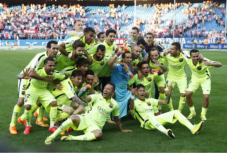 Barcelona players celebrate after winning the Spanish first division title following their soccer match against Atletico Madrid at at Vicente Calderon stadium in Madrid