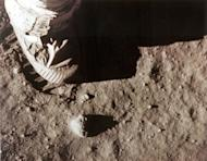 "In this photo from NASA, Apollo 11 commander Neil Armstrong's right foot leaves a footprint in the lunar soil July 20, 1969 as he and Edwin ""Buzz"" Aldrin became the first men to set foot on the surface of the moon"