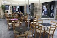 A man sits at an empty coffee shop in Old Nicosia in the Cypriot capital on June 22, 2012. Cyprus has requested assitance from its eurozone parters, becoming the fifth out the 17 countries to share the euro to seek a rescue