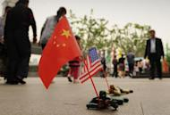 """Toy soldiers holding Chinese and US flags are seen for sale on a street in Shanghai on May 3, 2012. The United States has scrambled to contain a growing diplomatic row over the blind activist, who riled Chinese authorities by exposing forced abortions and sterilizations under the """"one-child"""" policy"""