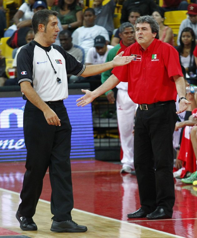 Mexico's coach Sergio Valdeomillos (R) is ejected by the referee during their FIBA Americas Championship final basketball game against Puerto Rico in Caracas September 11, 2013. REUTERS/Carlos Garcia Rawlins (VENEZUELA - Tags: SPORT BASKETBALL)