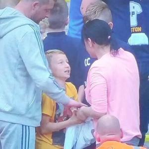 Woman swipes soccer jersey from 8-year old fan