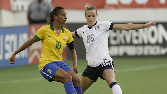 U.S. defender Leigh Ann Robinson (26) tries to get control of the ball away from Brazil midfielder Rosana (10) during the second half of an international friendly soccer match in Orlando, Fla., Sunday, Nov. 10, 2013. United States Women's national team defeated Brazil 4-1