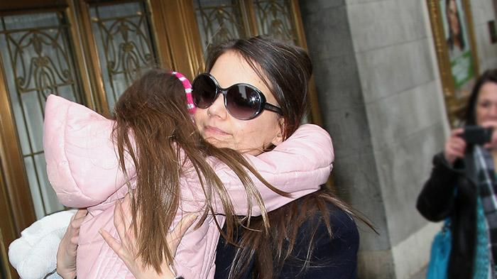 Katie Holmes spotted carrying her daughter Suri Cruise as she arrives at her Broadway show in NYC