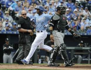 Alcides Escobar crosses home as he scores in the second inning Thursday. (Getty)