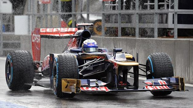 Toro Rosso's Australian driver Daniel Ricciardo arrives in the pits at Spa (AFP)