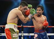 Manny Pacquiao punches Brandon Rios in their welterweight boxing bout in Macau on November 24, 2013