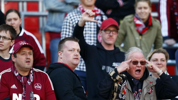 Nuremberg supporters react after their German first division Bundesliga match loss against Leverkusen in Nuremberg