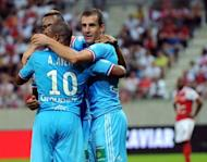 Marseille's French midfielder Benoit Cheyrou (R) celebrates with teammates after scoring during the L1 football match Reims vs Marseille at the Auguste Delaune stadium in Reims, eastern France. A Cheyrou goal 13 minutes from time handed Marseille a winning start to their French league season as they poached a 1-0 success at newly-promoted Reims