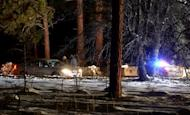 Law enforcement officers check cars at the roadblock near Angeles Oaks during a standoff with fugitive ex-cop Christopher Dorner, near San Bernardino, California, on February 12, 2013. Human remains found in a burnt-out mountain cabin in California have been confirmed as those of Dorner, the local coroner's office said on Thursday
