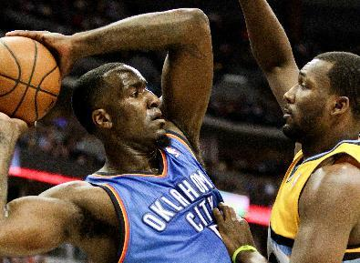 Oklahoma City Thunder's Kendrick Perkins, left, tries to pass around Denver Nuggets' Jordan Hamilton, right, during the third quarter of an NBA basketball game Tuesday, Dec. 17, 2013, in Denver. The Thunder won 105-93