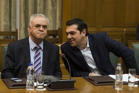 Greek Prime Minister Tsipras talks to Deputy Prime Minister Dragasakis during the first meeting of new cabinet post elections in the parliament building in Athens