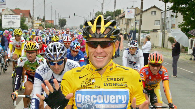 "FILE - In this July 24, 2005, file photo, overall leader Lance Armstrong signals seven for his seventh straight win in the Tour de France cycling race as he pedals during the 21st and final stage of the race between Corbeil-Essonnes, south of Paris, and the French capital. Armstrong confessed to using performance-enhancing drugs to win the Tour de France during a taped interview with Oprah Winfrey that aired Thursday, Jan. 17, 2013, reversing more than a decade of denial. Armstrong called his run to seven Tour de France titles ""so perfect for so long."" (AP Photo/Peter Dejong, File)"