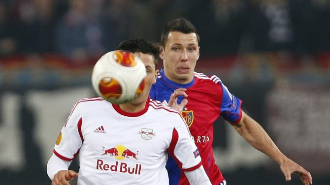 FC Basel's Suchy fights for the ball with Zulj of FC Salzburg during their Europa League round of 16 soccer match at St.Jakob-Park stadium in Basel