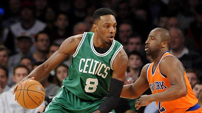Boston Celtics' Jeff Green (8) drives the ball against New York Knicks' Raymond Felton (2) during the first half of an NBA basketball game on Sunday, Dec. 8, 2013, in New York. The Celtics won 114-73
