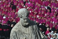 Bishops sit past a statue of St Peter during Pope Francis' grandiose inauguration mass at the Vatican, on March 19, 2013