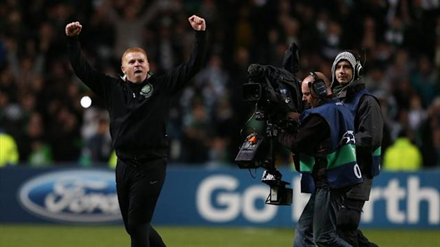 Celtic's manager Neil Lennon celebrates at the final whistle after a 2-1 win over Barcelona
