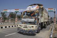 "A Pakistani truck passes through the Wagah checkpoint last month. Indian and Pakistani officials have been looking at the so-called ""China option"" as a model, with deepening economic engagement seen by experts as crucial to establishing lasting peace in the troubled region"