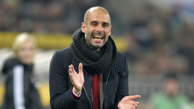 Bayern head coach Pep Guardiola of Spain claps his hands for his team during the German Bundesliga soccer match between Borussia Moenchengladbach and Bayern Munich in Moenchengladbach, Germany, Friday, Jan. 24, 2014. Bayern defeated Moenchengladbach with 2-0. (AP Photo/Martin Meissner)