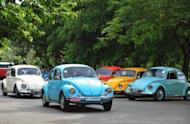Vintage Volkswagen Beetle cars at a rally in Colombo, Sri Lanka, last month. Volkswagen says net profits in the first half of the year soared by 36% as Europe's biggest car maker sold 4.6 mn cars worldwide