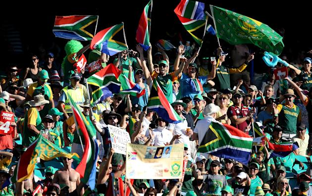 South African supporters cheer their team during their Cricket World Cup Pool B match against the West Indies in Sydney, Australia, Friday, Feb. 27, 2015. (AP Photo/Rick Rycroft)
