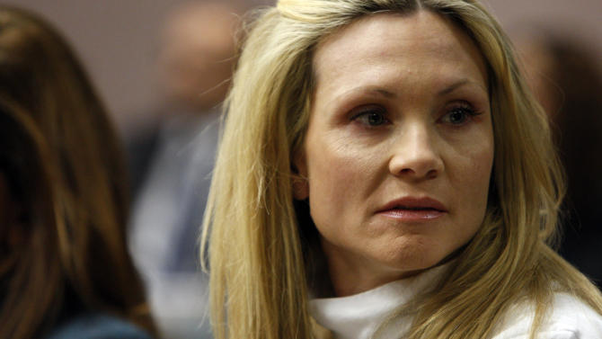 """FILE - This Nov. 27, 2012 file photo shows former """"Melrose Place"""" actress Amy Locane-Bovenizer in court as the jury in her trial returns a verdict in Somerville, N.J.  Locane-Bovenizer, who was driving drunk when her SUV plowed into a car and killed a New Jersey woman, was sentenced Thursday, Feb. 14, 2013, to three years in prison.  (AP Photo/The Star-Ledger, Robert Sciarrino, Pool)"""