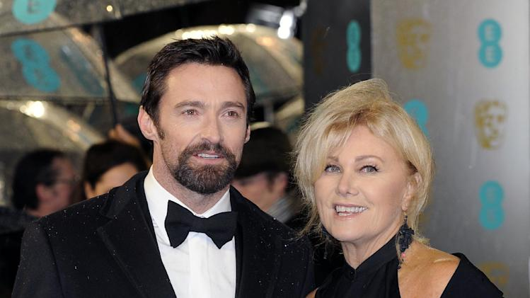 Hugh Jackman, left, and his wife Deborra-Lee Furness arrive for the BAFTA Film Awards at the Royal Opera House on Sunday, Feb. 10, 2013, in London. (Photo by Jonathan Short/Invision/AP)