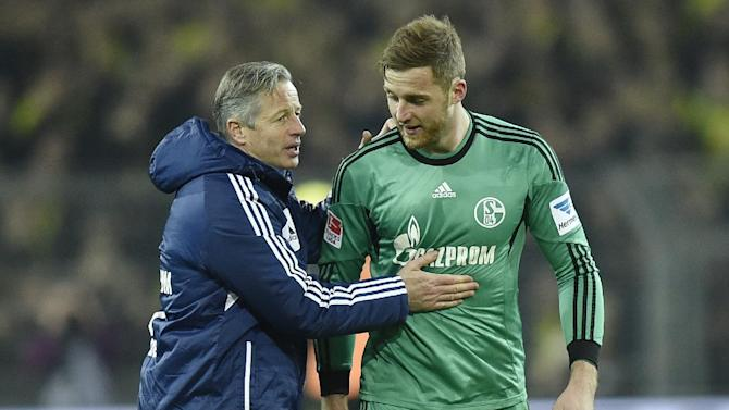 Schalke head coach Jens Keller thanks Schalke goalkeeper Ralf Faehrmann after  the German Bundesliga soccer match between Borussia Dortmund and FC Schalke 04 in Dortmund,  Germany, Tuesday, March 25, 2014