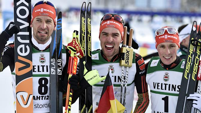 Johannes Rydzek, Eric Frenzel and Bjoern Kircheisen of Germany celebrate finishing the top three in the men's Nordic Combined individual Gundersen normal hill (HS100) ski jumping for the FIS Nordic Ski World Championships