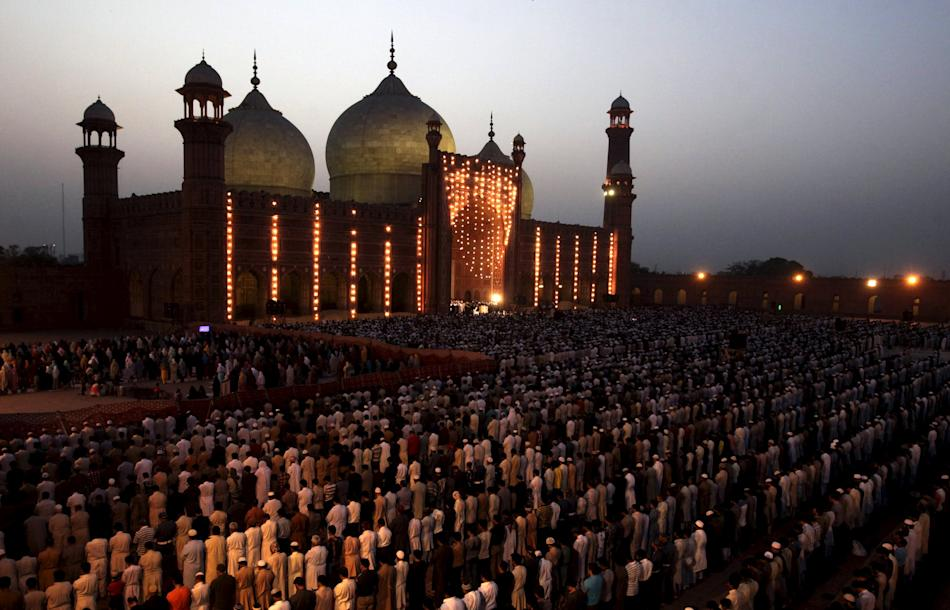People say their prayers under the leadership of Saudi Arabian Imam of the Grand Mosque Sheikh Khalid al Ghamdi during evening prayers at the Badshahi mosque in Lahore